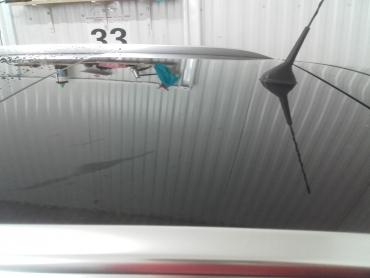 Renault dach po delikatnym gradzie Bezlakierowo.pl - bzlakierowe usuwanie wgniecen w karoserii samochodowej